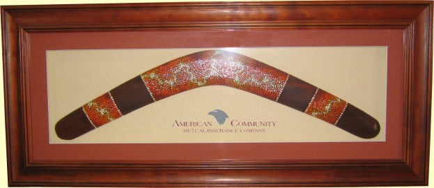Framed Aboriginal dot art boomerang, 22 inch. Printed logo