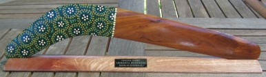 Dot art hunting boomerang on stand with engraved logo