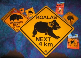 range of road signs, left to right - small sign, magnet, sticker, large sign, key ring, swing sign, set of coasters